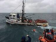 Image of U.S. Coast Guard assisting a fishing vessel