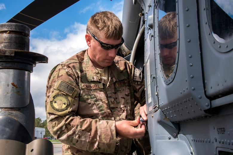 Tech. Sgt. Jesse Cardwell, 723d Aircraft Maintenance Squadron (AMXS) crew chief, tightens a bolt on an HH-60G Pavehawk, Feb. 27, 2018, at Moody Air Force Base, Ga. They were evaluated on their ability to unfold the tail and main rotors of a Pavehawk to practice making the helicopter operational in a limited amount of time. (U.S. Air Force photo by Airman Eugene Oliver)