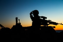 A Marine with 1st Light Armored Reconnaissance Battalion, 1st Marine Division adjusts his night vision as the sun set on Marine Corps Base Camp Pendleton, Calif.
