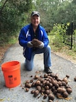 Steve Danner shows off the second largest air potato found at Tree Hill Nature Center