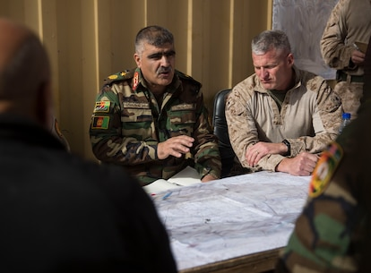 Afghan National Army Brig. Gen. Abdul Hadi, the deputy commander of the 215th Corps, discusses future objectives during a key leader engagement in Helmand Province, Afghanistan, Dec. 26, 2017. Task Force Southwest is advising and assisting the 1st Brigade as they clear southern Marjah as part of the Maiwand 10 mission. This is a joint operation with maneuver elements from the Afghan National Army, National Directorate of Security and Afghan National Police forces. (U.S. Marine Corps photo by Sgt. Justin T. Updegraff)
