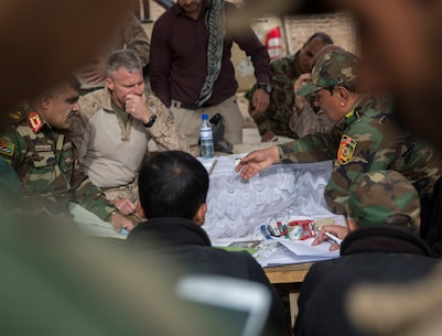 Afghan National Army Brig. Gen. Abdul Raziq Hotak, the commander of the 1st Brigade, 215th Corps discusses recent advances made by the 1st Brigade during operation Maiwand 10 in Helmand Province, Afghanistan, Dec. 26, 2017.  Task Force Southwest is advising and assisting the 1st Brigade as they clear southern Marjah as part of the Maiwand 10 mission. This is a joint operation with maneuver elements from the Afghan National Army, National Directorate of Security and Afghan National Police forces. (U.S. Marine Corps photo by Sgt. Justin T. Updegraff)