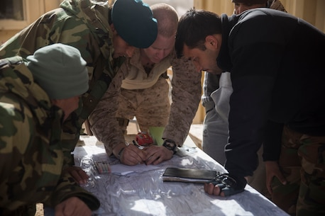 A U.S. Marine advisor with Task Force Southwest teaches various techniques on how to plot and mark friendly and enemy locations on a map during operation Maiwand 10 in Helmand Province, Afghanistan, Dec. 27, 2017. Task Force Southwest is advising and assisting the 1st Brigade as they clear southern Marjah as part of the Maiwand 10 mission. This is a joint operation with maneuver elements from the Afghan National Army, National Directorate of Security and Afghan National Police forces. (U.S. Marine Corps photo by Sgt. Justin T. Updegraff)