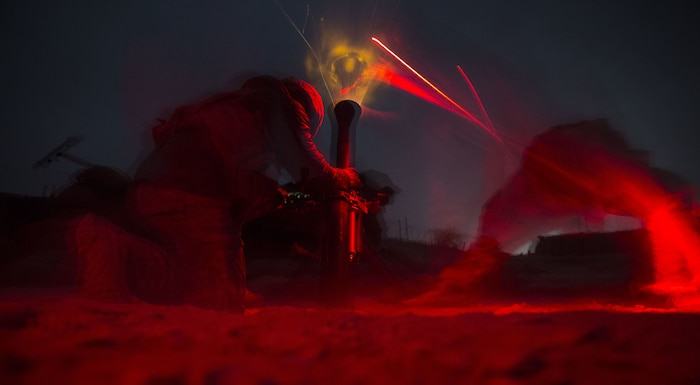 U.S. Army Soldiers with Alpha Company, 2-501st Parachute Infantry Regiment, fire an 81mm mortar in support of the Afghan National Army during operation Maiwand 10 in Helmand Province, Afghanistan, Dec. 26, 2017. The Soldiers fired multiple illumination rounds in order to light a nearby area of Marjah where the ANA experienced a nighttime ambush. (U.S. Marine Corps photo by Sgt. Justin T. Updegraff)