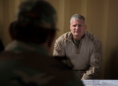 U.S. Marine Brig. Gen. Roger Turner, the commanding general of Task Force Southwest, listens to Afghan National Army Brig. Gen. Abdul Raziq Hotak, the commander of the 1st Brigade, as he details his course of action over the next few days for operation Maiwand 10 in Helmand Province, Afghanistan, Dec. 26, 2017. Task Force Southwest is advising and assisting the 1st Brigade as they clear southern Marjah as part of the Maiwand 10 mission. This is a joint operation with maneuver elements from the Afghan National Army, National Directorate of Security and Afghan National Police forces. (U.S. Marine Corps photo by Sgt. Justin T. Updegraff)