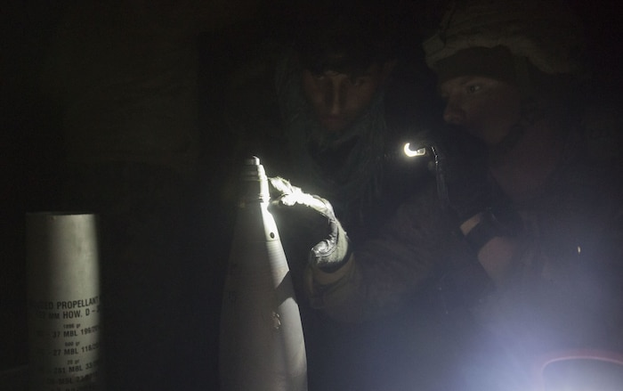 A U.S. Marine advisor with Task Force Southwest verifies the fuse timing on a 122mm round to ensure precise illumination at the intended target during Maiwand 10 in Helmand Province, Afghanistan, Dec. 27, 2017. The artillerymen with 1st Brigade, 215th Corps fired an illumination round near a bed-down site to raise the morale of the Afghan National Army Soldiers, showcasing that they can provide artillery support at any time during the operation. (U.S. Marine Corps photo by Sgt. Justin T. Updegraff)