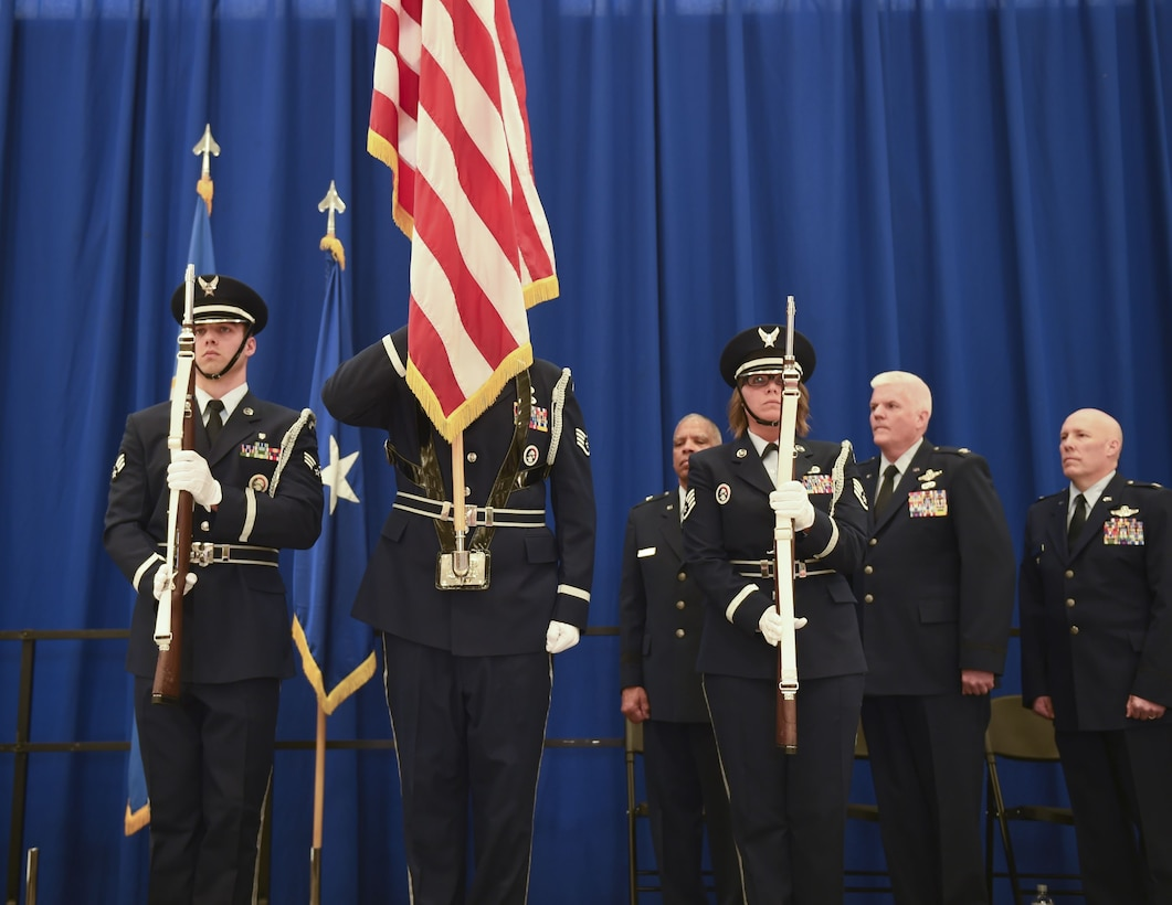 The 133rd Airlift Wing Base Color Guard presents the colors during the Wing change of command ceremony in St. Paul, Minn. Apr. 16, 2016.