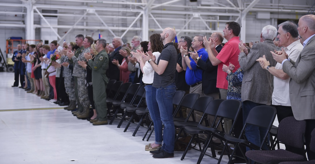 U.S. Air Force Airmen from the133rd Airlift Wing, along with friends and family members of U.S. Air Force Cols. James Johnson and Daniel Gabrielli, gather for a change of command ceremony in St. Paul, Minn., Apr. 16, 2016.