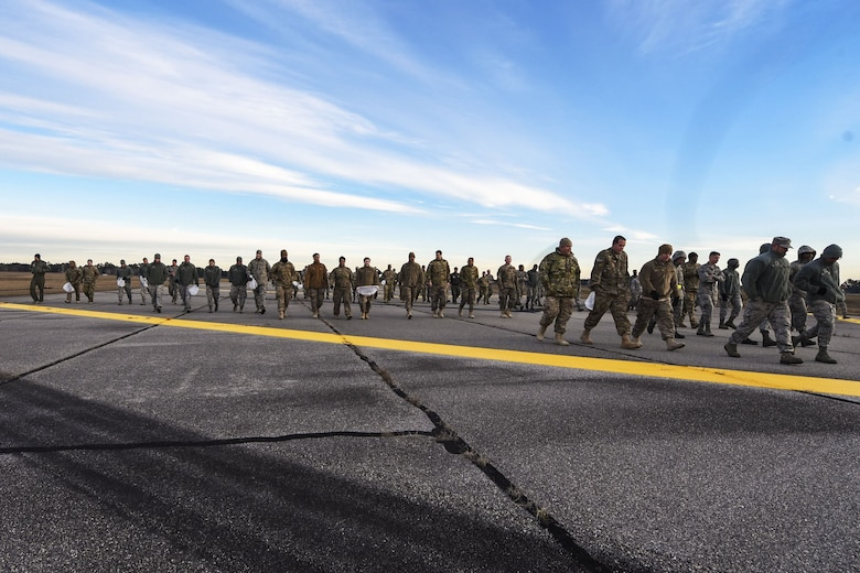Team Moody Airmen, walk on the flight line during a foreign object debris (FOD) walk, Jan. 2, 2018, at Moody Air Force Base, Ga.  The FOD walk was performed following the winter holidays to remove any debris that could potentially cause damage to aircraft or vehicles. (U.S. Air Force photo by Airman Eugene Oliver)
