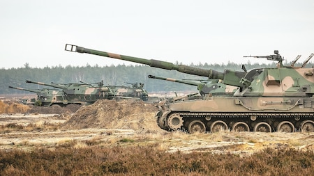 Polish Howitzers at Presidenski Range in Trzebian, Poland, wait to deliver artillery to distant targets during a multinational live-fire exercise involving Polish and U.S. forces on Nov. 29.