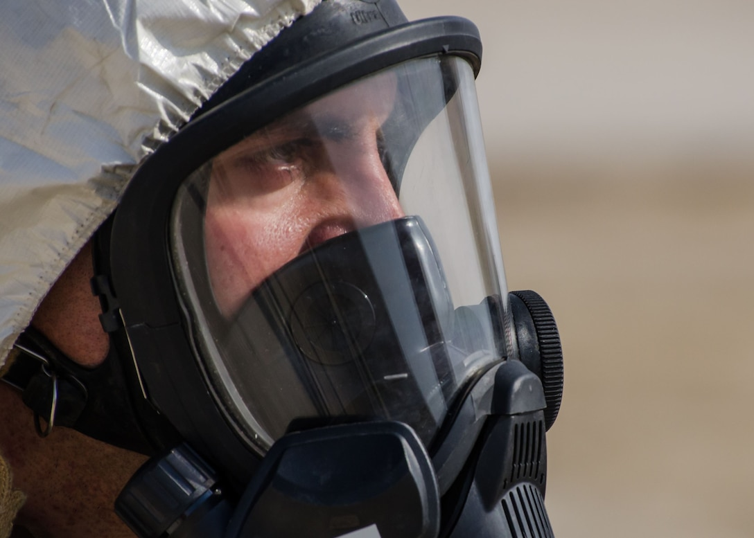 Tech Sgt. Charles Piccolomini, 380th Expeditionary Civil Engineer Squadron, explosive ordnance disposal, logistics section chief, observers the scene of an F-22 Raptor crash during the base-wide Major Accident Response Exercise at Al Dhafra Air Base, United Arab Emirates Dec. 15, 2017. EOD is trained to detect, disarm, detonate and dispose of explosive threats. (U.S. Air National Guard Photo by Staff Sgt. Colton Elliott)