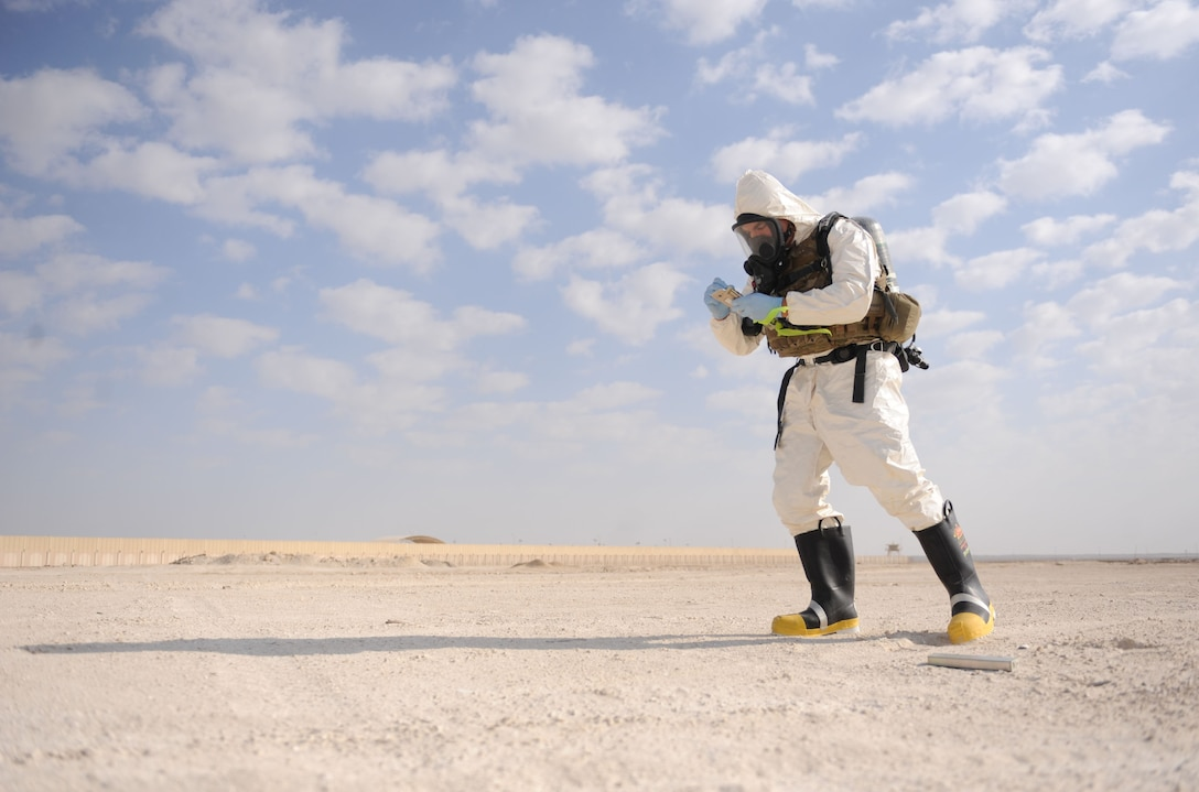 Staff Sgt. Benjamin Young, 380th Expeditionary Civil Engineer Squadron, explosive ordnance disposal, training noncommissioned officer in charge, evaluates the scene of an F-22 Raptor crash during the Major Accident Response Exercise at Al Dhafra Air Base, United Arab Emirates Dec. 15, 2017. EOD is trained to detect, disarm, detonate and dispose of explosive threats. (U.S. Air National Guard Photo by Staff Sgt. Colton Elliott)
