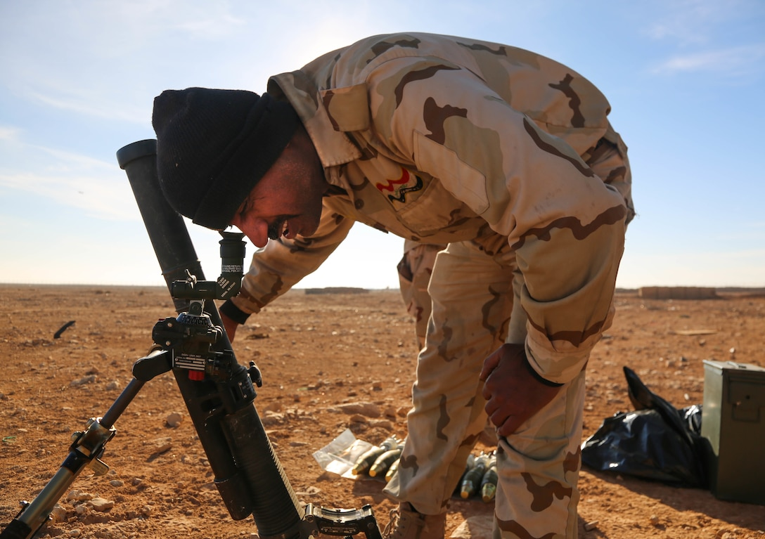 An Iraqi soldier aims a mortar tube to ensure proper targeting during a live fire exercise near Camp Al Asad, Iraq, Dec. 27, 2017. This training is part of the overall Combined Joint Task Force – Operation Inherent Resolve building partner capacity mission which focuses on training and improving the capability of partnered forces fighting ISIS. CJTF-OIR is the global Coalition to defeat ISIS in Iraq and Syria. (U.S. Army photo by Spc.Travis Jones)