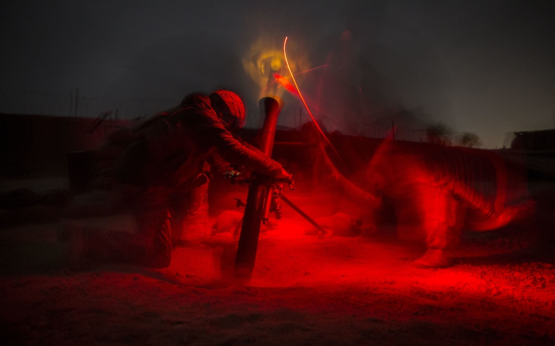 U.S. Army Soldiers with Alpha Company, 2-501st Parachute Infantry Regiment, fire an 81mm mortar in support of the Afghan National Army during operation Maiwand 10 in Helmand Province, Afghanistan, Dec. 26, 2017. The Soldiers fired multiple illumination rounds in order to light a nearby area of Marjah where the ANA were involved in a nighttime ambush. (U.S. Marine Corps photo by Sgt. Justin T. Updegraff)