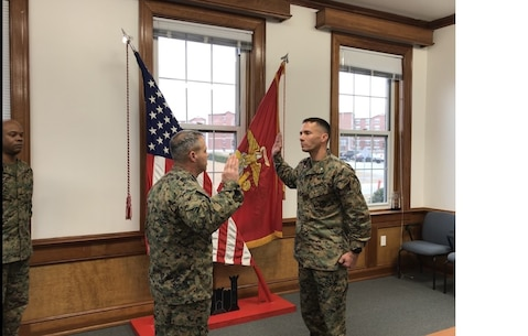 On January 3, 2018 Thomas M. Hollman, Operations Officer for Marine Corps Engineer School; is promoted to the rank of Lieutenant Colonel in the headquarters building conference room in front of Marines, colleagues, and friends.  Colonel James H. Bain, Commanding Officer of Marine Corps Engineer School; administers the Oath of Office.
