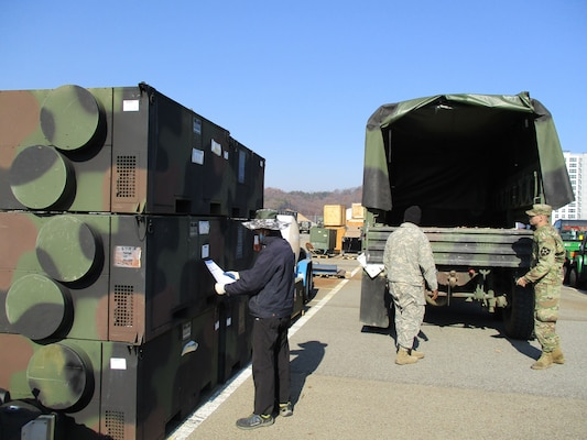 Gimcheon staff member helps soldiers locate the environmental control units that will heat up their winter training.