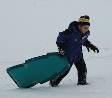 child sledding