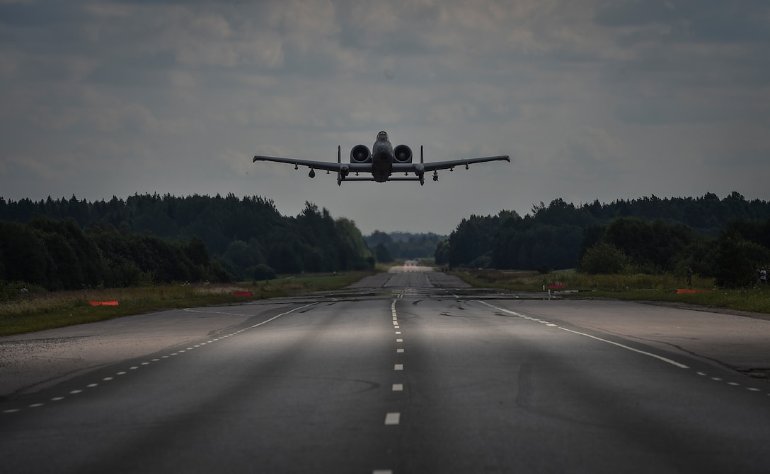 An A-10C Thunderbolt II aircraft from the 175th Wing, Maryland Air National Guard, prepares to land on the Jägala-Käravete Highway in Estonia, Aug. 10, 2017. Combat controllers from the 321st Special Tactics Squadron surveyed the road, deconflicted airspace and exercised command and control on the ground and in the air as part of an interoperability exercise with the Estonian military.(U.S. Air Force photo by SrA Ryan Conroy)