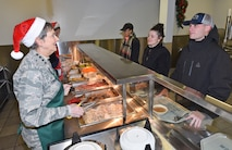 General Pawlikowski serving dinner to Airmen
