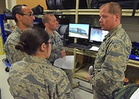 711th Human Performance Wing students talk with director