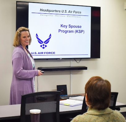 Dawn Beal is the 341st Missile Wing key spouse group program coordinator. She poses for a photo in front of an orientation slide Dec. 28, 2017, at the Airman and Family Readiness Center, Malmstrom Air Force Base, Mont. where she has been a long-time community readiness consultant. (U.S. Air Force photo by Kiersten McCutchan)