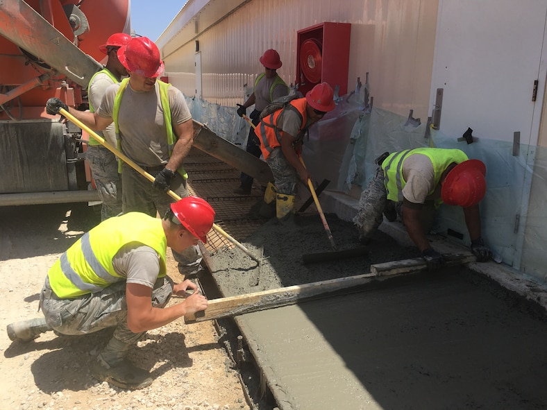 Members of the 219th RED HORSE Squadron of the Montana Air National Guard finish a concrete sidewalk on an Israeli Defense Force base. (U.S. Air National Guard photo)
