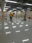 Members of the 219th RED HORSE Squadron of the Montana Air National Guard apply an epoxy finish to a floor in a building located on an Israeli Defense Force base. (U.S. Air National Guard photo)
