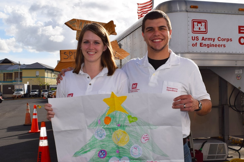 Leah and Evan Morgan, husband and wife team from Huntington District, Army Corps of Engineers, share the hand-drawn Christmas tree.