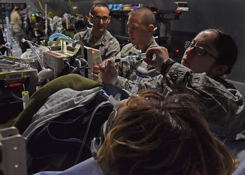 U.S. Air Force Capt. Andrew Hersh, Critical Care Air Transport physician from Joint Base San Antonio, Texas; U.S. Air Force Capt. Matthew Thompson, CCAT nurse from Keesler Air Force Base, Biloxi, Miss.; and Senior Airman Alysia Bator, CCAT respiratory therapist from Westover Air Reserve Base, Chicopee, Mass., test their clinical skills during the two-week CCAT Initial Course inside the USAFSAM lab at Wright-Patterson Air Force Base, Ohio, Dec. 8, 2017. (U.S. Air Force photo by Michelle Gigante)