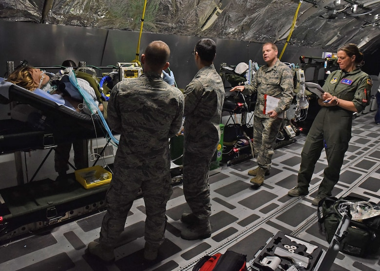 U.S. Air Force Lt. Col. Greg Malone, Critical Care Air Transport medical director at the U.S. Air Force School of Aerospace Medicine, 711th Human Performance Wing, speaks to a CCAT team after evaluating their clinical skills during CCAT training inside the USAFSAM lab at Wright-Patterson Air Force Base, Ohio, Dec. 8, 2017. The students were being evaluated on preparing a simulated patient for flight. (U.S. Air Force photo by Michelle Gigante)