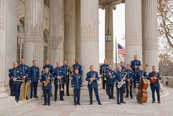 The Airmen of Note pose for a picture on the steps of Constitution Hall during this year's annual Holiday Concerts (U.S. Air Force photo by CMSgt Kevin Burns/released)
