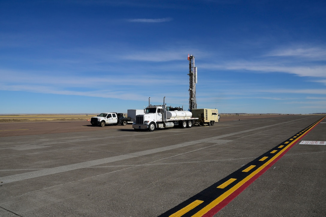 Contract environmental well drillers drill a water well on the ramp of the 120th Airlift Wing in Great Falls, Mont. Sept. 21, 2017. The wells will be tested and monitored for contaminants as part of the ongoing Installation Restoration Program on the Montana Air National Guard base. (U.S. Air National Guard photo/Senior Master Sgt. Eric Peterson)