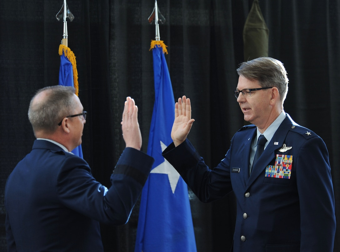 """U.S. Air Force Brig. Gen. James """"Bob"""" Stevenson Jr. is administered the Oath of Office by Maj. Gen. Daryl Bohac, Nebraska adjutant general, following his promotion to general officer and assumption of the position of assistant adjutant general for air of the Nebraska Air National Guard during a formal ceremony held Dec. 2, 2016 at the Nebraska Joint Force Headquarters in Lincoln, Nebraska. All Airmen take an oath upon entry into the service. Officers take the Oath of Office upon commissioning and renew that oath with each promotion. Enlisted members take the Oath of Enlistment upon entry and again each time they re-enlist."""