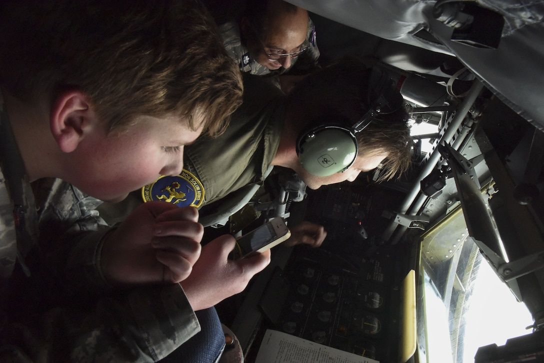 A Civil Air Patrol cadet and senior member look on as Staff Sgt. F Jervis, 351st Air Refueling Squadron boom operator, refuels an F-16 Fighting Falcon over Germany, Dec. 19, 2017. The tanker offloaded 30 tons of fuel to six F-16s from the 52nd Fighter Wing at Spangdahlem Air Base, Germany. (U.S. Air Force photo by Senior Airman Kelly O'Connor)