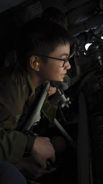 A Civil Air Patrol cadet controls the boom from the boom operator's position following an air refueling mission over Germany, Dec. 19, 2017. The Civil Air Patrol mission overseas highly emphasizes the cadet program and aerospace education. (U.S. Air Force photo by Senior Airman Kelly O'Connor)