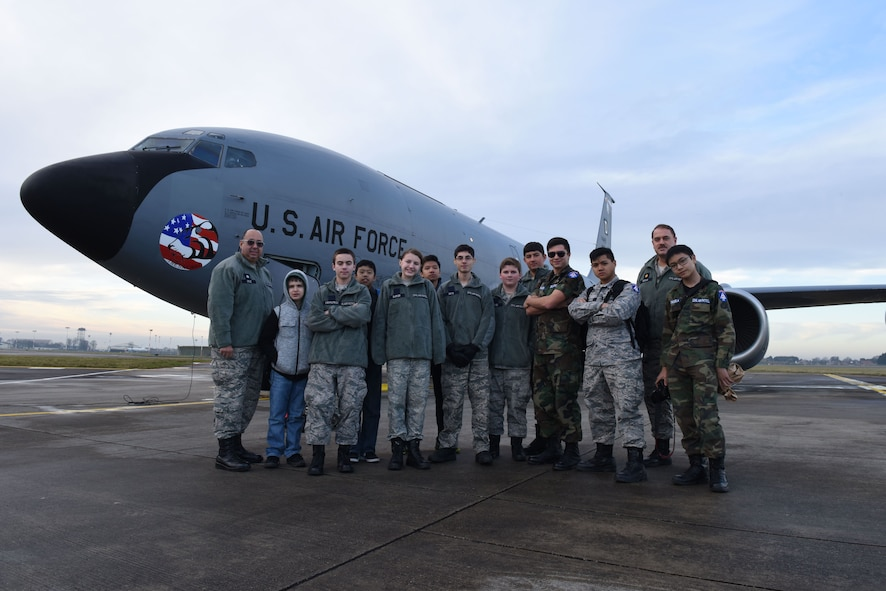 The Civil Air Patrol, 'National Headquarters 128' based in RAF Mildenhall, cadets and senior members pose for a group photo in front of a KC-135 Stratotanker following the air refueling mission Dec. 19, 2017. The flight was three and a half hours long, and the mission was a complete success. (U.S. Air Force photo by Senior Airman Kelly O'Connor)