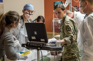 Staff at Madigan Army Medical Center in Tacoma, Wash., treat patients. The 2017 results of the Defense Department's Joint Outpatient Experience Survey show an increase in patient satisfaction with military medical facilities and pharmacy care.
