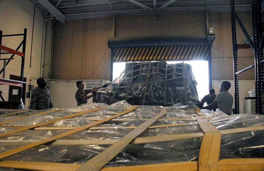 Airmen with the  51st Combat Communications Squadron at Robins Air Force Base prepare their pallets for a deployment exercise.