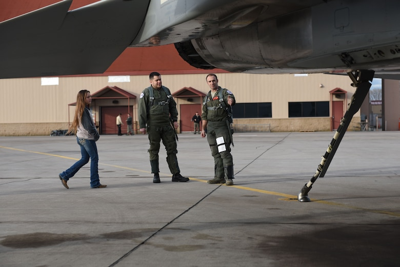 U.S. Air Force Maj. William Sullivan, an instructor pilot with the 173rd Fighter Wing, shows A.J. Davila, a local college adjunct professor and veteran's affairs advocate, around the aircraft prior to boarding for a civic leader flight, Jan. 3, 2018.