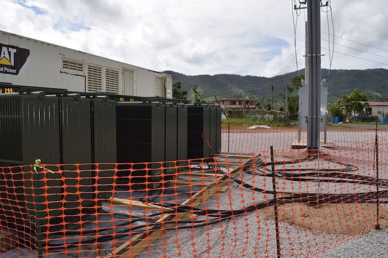 "Large transformers, along with 1,850 kilowatt generators form the microgrid system, provide temporary power to Maunabo, Puerto Rico, until the main grid is back online. ""We are taking one or more 1,850 kilowatt generators, the huge ones you find powering hospitals and big box stores, and with the use of transformers, set up at a site. We then hook directly into the Puerto Rico Electric Power Authority infrastructure through a substation or directly into the main grid, and push power to a variety of facilities that are on the line that haven't been damaged and can accept it."""
