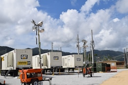 "The microgrid temporary power system continues to supply critical power in Maunabo, Puerto Rico, until the town's main grid is back online. ""A microgrid can take many forms,"" said USACE Task Force Power Restoration Operations Officer Capt. Aaron Anderson. ""We are taking one or more 1,850 kilowatt generators, the huge ones you find powering hospitals and big box stores, and with the use of transformers, set up at a site. We then hook directly into the Puerto Rico Electric Power Authority infrastructure through a substation or directly into the main grid, and push power to a variety of facilities that are on the line that haven't been damaged and can accept it."""