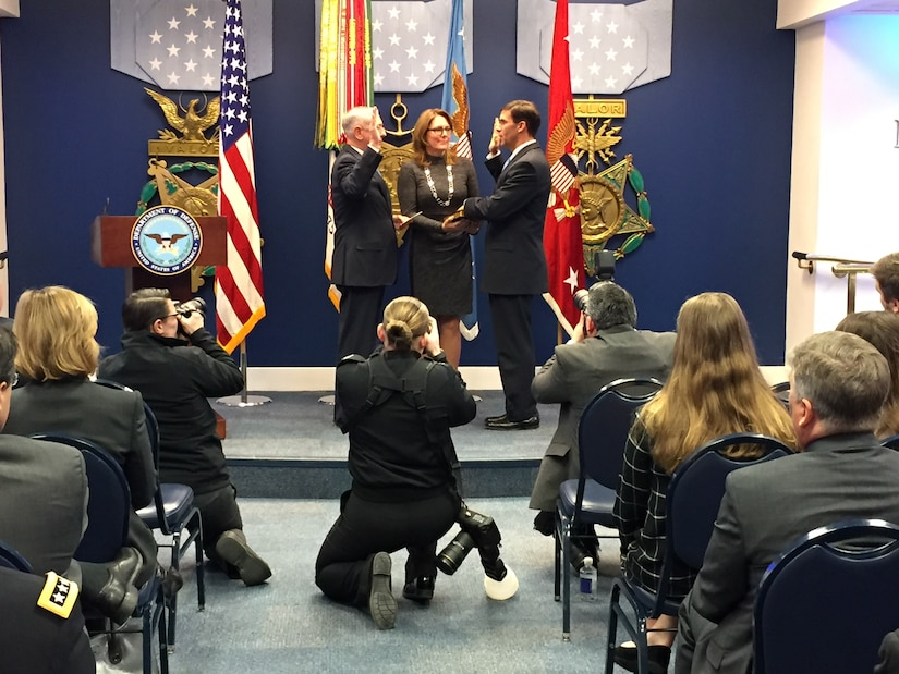 Defense Secretary James N. Mattis, left, administers a ceremonial oath of office to Army Secretary Mark T. Esper at the Pentagon's Hall of Heroes, Jan. 5, 2018. Esper's wife, Leah, holds the Bible.