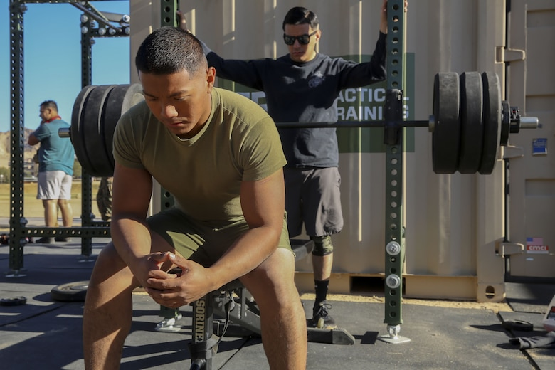 Cpl. Raul Ebanies, embark, Marine Wing Support Squadron 374, prepares his mind to reach a new personal record of 280-pounds during the Iron Rhino weightlifting competition at Del Valle High Intensity Tactical Training field aboard the Marine Corps Air Ground Combat Center, Twentynine Palms, Calif., Dec. 13, 2017. The Iron Rhino event was the first weightlifting competition hosted by MWSS-374 where competitors had three attempts to reach their maximum deadlift, bench, and squat, to claim the title of Iron Rhino. (U.S. Marine Corps photo by Cpl. Christian Lopez)