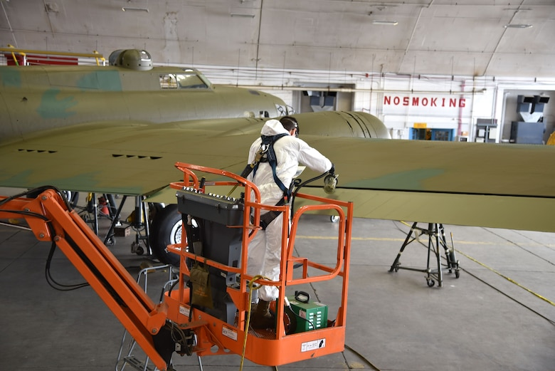 DAYTON, Ohio (12/28/2017) -- National Museum of the U.S. Air Force restoration specialist Casey Simmons paints the flight control surfaces on the Boeing B-17F Memphis Belle™. Plans call for the aircraft to be placed on permanent public display in the WWII Gallery here at the National Museum of the U.S. Air Force on May 17, 2018. (U.S. Air Force photo by Ken LaRock)