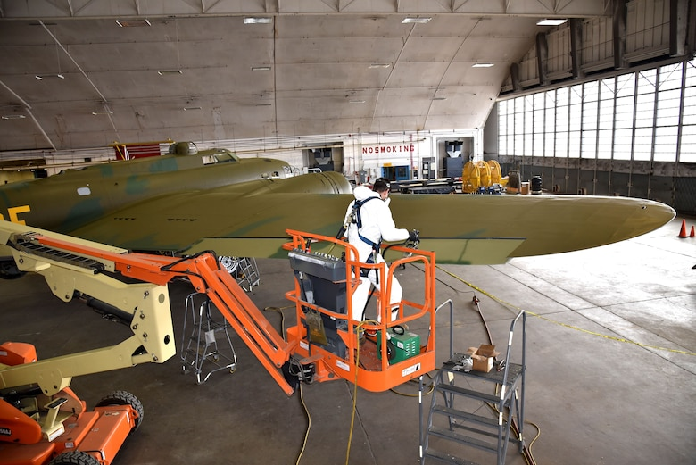 DAYTON, Ohio (12/28/2017) -- National Museum of the U.S. Air Force restoration specialist Casey Simmons paints the control surfaces on the Boeing B-17F Memphis Belle™. Plans call for the aircraft to be placed on permanent public display in the WWII Gallery here at the National Museum of the U.S. Air Force on May 17, 2018. (U.S. Air Force photo by Ken LaRock)