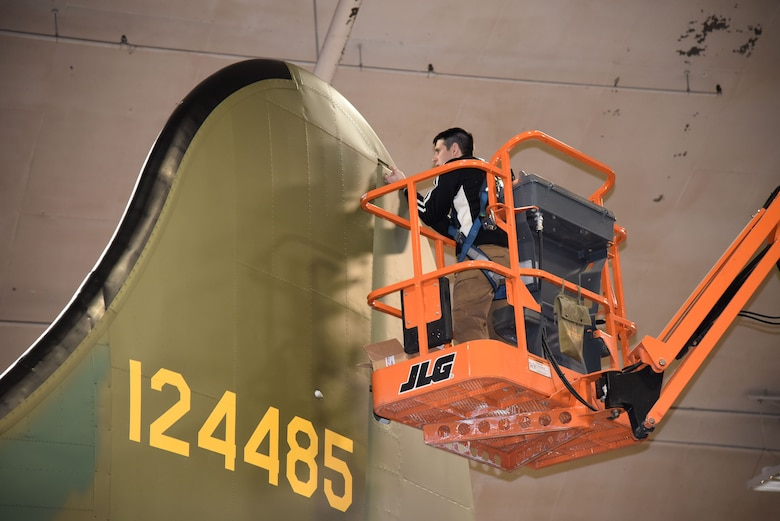 DAYTON, Ohio (12/28/2017) -- National Museum of the U.S. Air Force restoration crews install the flight control surfaces on the Boeing B-17F Memphis Belle™. Plans call for the aircraft to be placed on permanent public display in the WWII Gallery here at the National Museum of the U.S. Air Force on May 17, 2018. (U.S. Air Force photo by Ken LaRock)