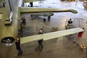 DAYTON, Ohio (11/8/2017) -- National Museum of the U.S. Air Force restoration crews install the flight control surfaces on the Boeing B-17F Memphis Belle™. Plans call for the aircraft to be placed on permanent public display in the WWII Gallery here at the National Museum of the U.S. Air Force on May 17, 2018. (U.S. Air Force photo by Ken LaRock)
