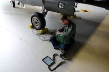 The tester transmits data to the F-16CM Fighting Falcon and the EMS inspection team tests the aircraft's results against the information from the tester.