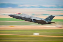 A 56th Fighter Wing F-35A Lightning II pilot takes off from Luke Air Force Base, Ariz., July 17, 2017. F-35 basic course students took part in a two and a half week, four flight phase replicating a wartime environment designed to test their training and skills. Today's flight featured six F-35's facing off against eight F-16 Fighting Falcons in defensive counter air attack operation measures. The students will be the first ever to graduate from a course designed specifically to utilize the mission set of the F-35. (U.S. Air Force photo/Airman 1st Class Caleb Worpel)