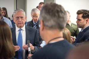 Defense Secretary James N. Mattis speaks with reporters.